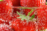 Strawberries in water close up