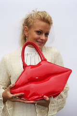 A girl holding a red bag
