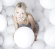 Beautiful young glamour girl with white balloons
