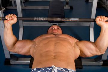 Bodybuilder training in the gym -bench press