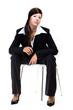 Junge Frau auf Stuhl
