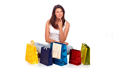 Beautiful woman sitting with bags and thinking