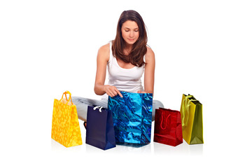 Young woman sitting and looking in a bag