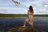 Cute girl interacting with wildlife, marshes and fresh water poster