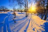 Fototapety Beautiful sunset in winter park