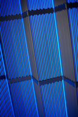 Metal tubes in blue glow.