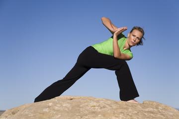 Yoga woman leaning forward