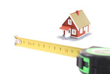 The tool for measurement of length and little house over white. poster