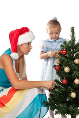 Girl with mum decorates a Christmas tree.