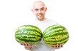 Man with two watermelons show double growth