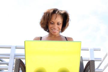 Mixed Race Latin Girl Smiles at Laptop