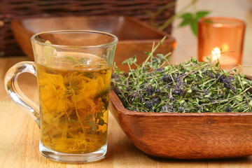 Herbs in glass and bowl
