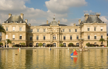 Luxembourg palace with toy boats in the pond in front of it