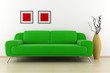 green sofa and vase with dry wood in front of white wall