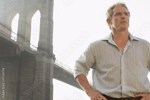 man with bridge in background