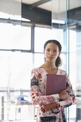 office worker carrying file folder