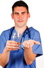 Doctor holding a pill and a glass of water