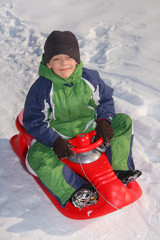 Child on sledge