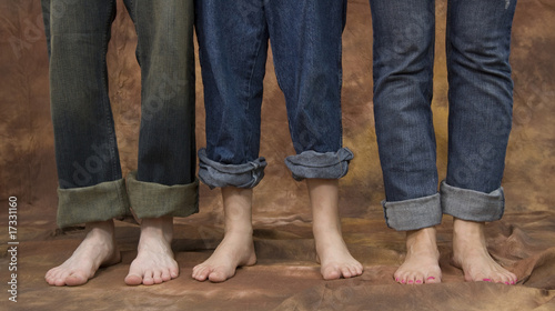 Three pairs of feet isolated on a background