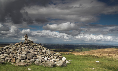 Rocky cairn on Dartmoor with cloudy sky