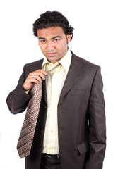 Tired Businessman Removing Tie