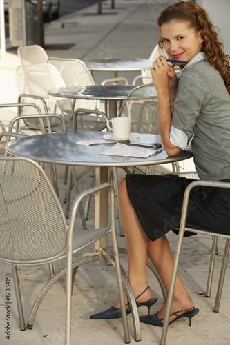 businesswoman at sidewalk cafe