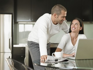 young couple using laptop