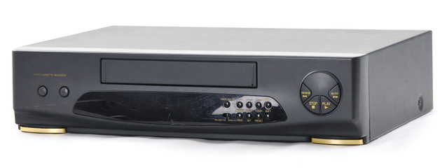 Old video cassette recorder on the white. Front side.