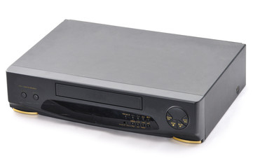 Old video cassette recorder on the white background.