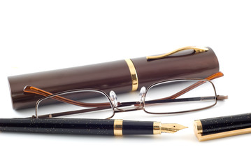 Spectacles and pen