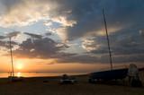 alba sul mare con barche poster