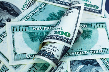 Green one hundred dollar banknotes background with roll