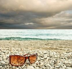 sun glasses on a seashore