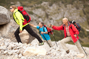 colorful hiking group on rocky terrain