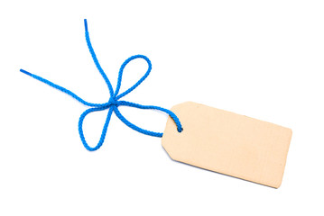 Blank cardboard tag with bow. Blue shoelace
