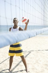 Young man playing beach volleyball