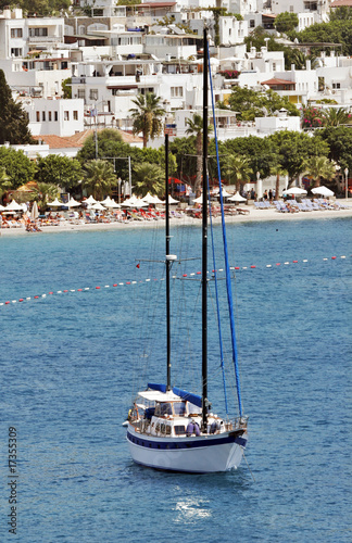 seascape with anchored sailboat off the beach, Bodrum, Turkey