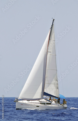 cruising sailboat speeding at open sea