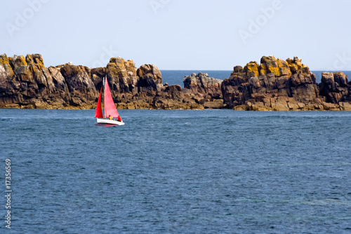 Red sailboat in the Atlantic Ocean
