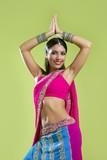 Fototapety Beautiful Indian Young Brunette Woman Dancing