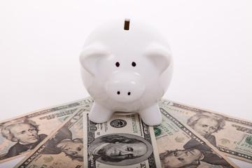 piggybank over dollar bills
