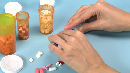 Woman sorting pills
