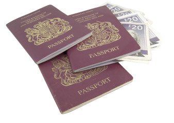 three passports and money isolated on white background