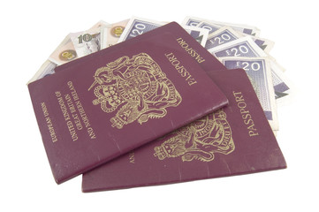 british passports and money isolated on white background