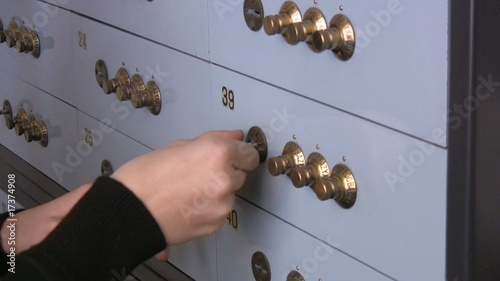 Woman closing a safe in the bank