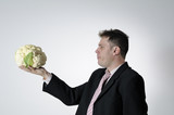 businessman evaluating cauliflower poster