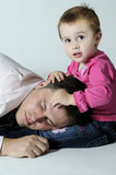 man slepping and little girl