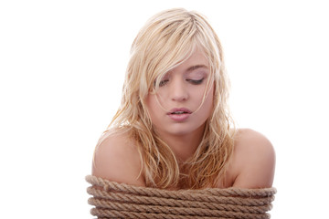 The beautiful blond girl tied with rope