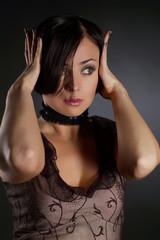 Attractive brunette in studio on dark  background2