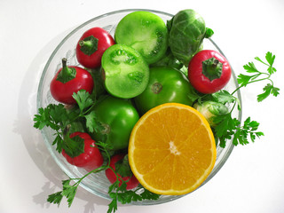 Fresh vegetables and fruits in round bowl made of glass